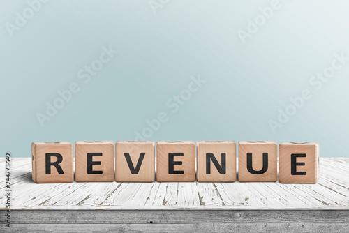 Fotografía  Revenue sign on a wooden desk