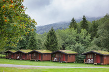 Turf Roof Wooden Camping Cabin...