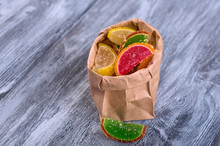 Colored Candy In Paper Bags On...