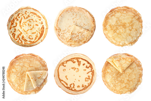 Set of hot tasty thin pancakes on white background, top view