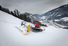 Snow Groomer On Ski Slope