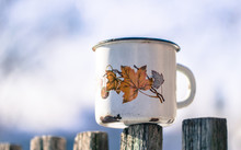 Old Leaky Mug And Winter Garden. Winter In Canada
