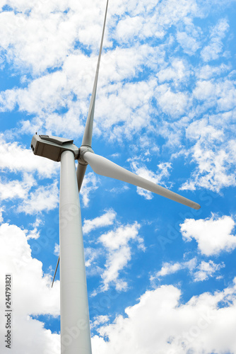 The wind generator is in bright cloudy sky. Eco energy concept. Canvas Print