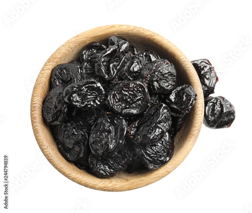 Bowl of tasty prunes on white background, top view. Dried fruit as healthy snack