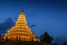 Wat Huay Pla Kang, Beautiful Golden Pagoda Chinest Style Decorate With Lighting At Night With Cloudy Sky Background, Chinese Temple In Chiang Rai, Thailand.
