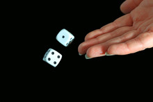 A Hand Rolling Dice