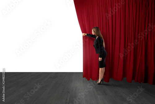 Leinwand Poster Woman open red curtains of the theater stage