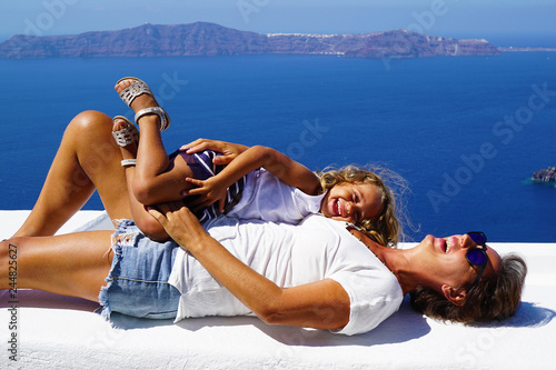 Fotografering  Tourists relaxing in the sun in Santorini island