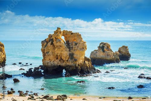 Valokuva  Rocks in blue ocean in sunny day