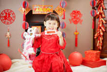 Chinese Baby Girl Holding A Da...