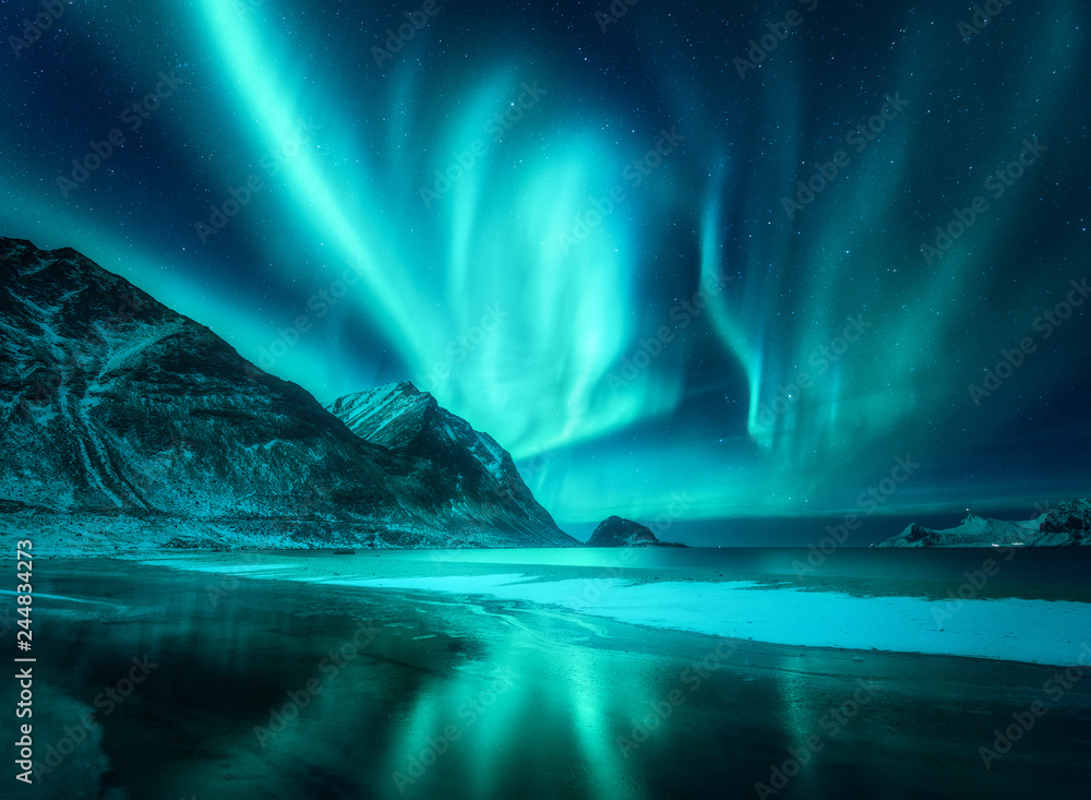 Fototapety, obrazy: Amazing aurora borealis. Northern lights in Lofoten islands, Norway. Starry sky with polar lights. Night winter landscape with aurora, sea with frosty coast and sky reflection, snowy mountains. Travel