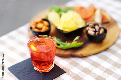 Fotografija Italian aperitives/aperitif: glass of cocktail (sparkling wine with Aperol) and