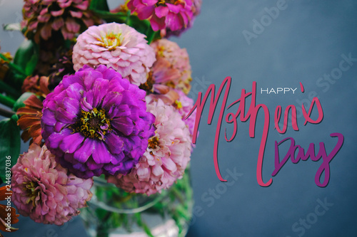 Pink Zinnia flowers on chalkboard background with Mother's Day text. - 244837036