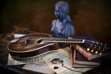 Still Life With Antique Mandolin And Music Notes