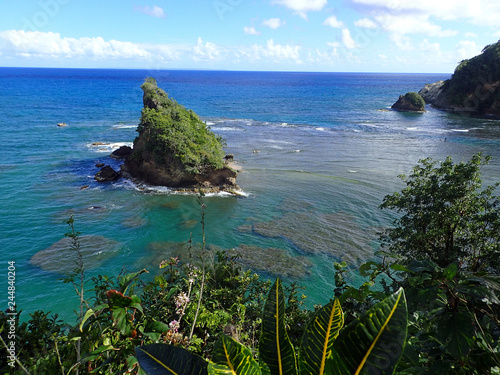 Fotografia  Exotic, scenic view of Atlantic Ocean with reefs and rocks from the tropical island of Dominica, Lesser Antilles, Windward Islands of the Caribbean