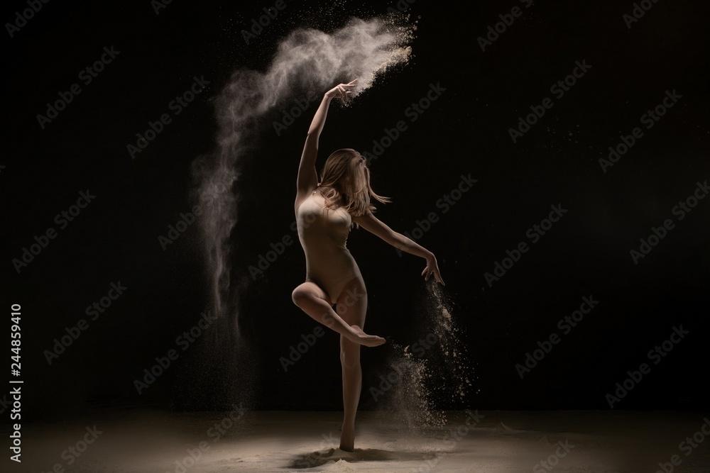 Fototapeta Sexy girl dancing gracefully in white dust cloud