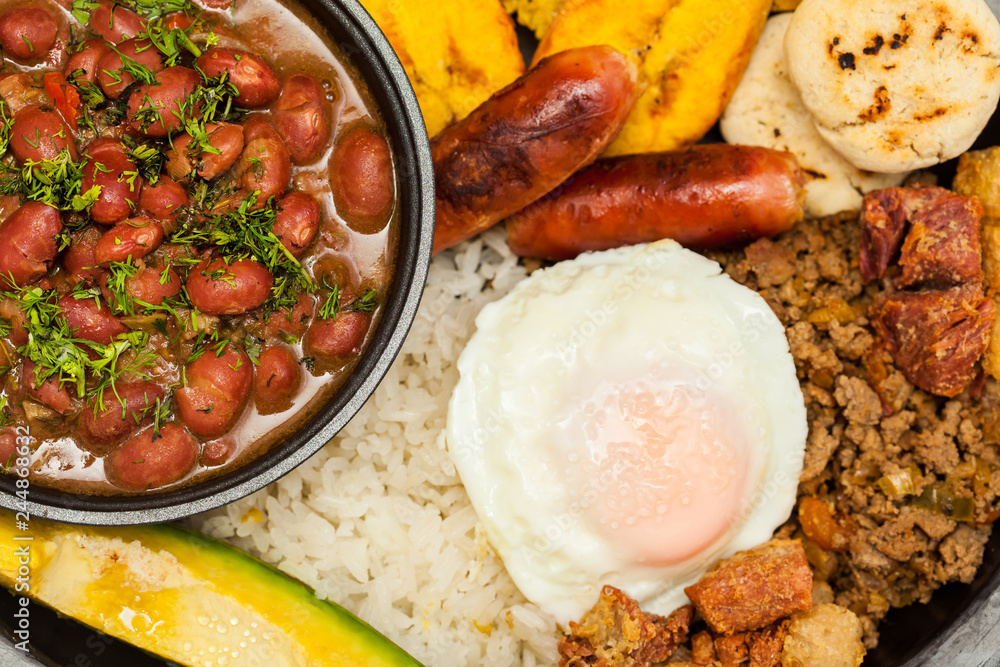 Fototapety, obrazy: Traditional Colombian dish called Banda paisa: a plate typical of Medellin that includes meat, beans, egg and plantain