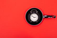 Top View Of Alarm Clock In Pan...
