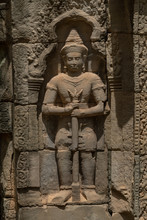 Stone Statue Of Man In Wall Alcove