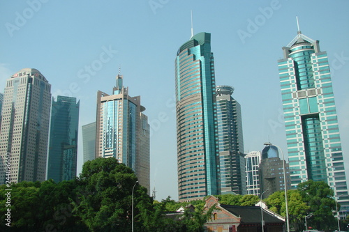 Panorama of streets with high skyscrapers in the modern business districts of the great Chinese city against the background of the spring sky.