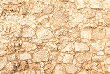 Background Of Ancient Brick Wall. Texture Of Old Amphitheater Stone. Texture Of An Ancient Brick Wall Made Of Sandstone. Archaeological Excavations