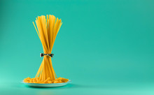 Bunch Of Spaghetti Standing Upright On A Bright Colored Background. Horizontal.