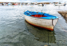 Small Old Fishing Boat In A Ha...