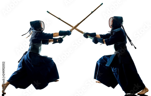 two Kendo martial arts fighters combat fighting in silhouette isolated on white Fototapet