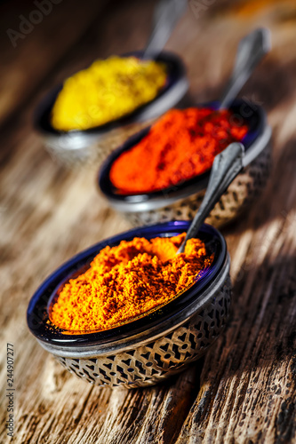 Tuinposter Kruiderij spices,Indian spices, color full spices in glass bowls