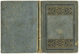 Old open book cover in grey canvas with embossed golden abstract and floral decorations (circa 1880), isolated on white, beautiful details