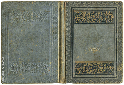 Photographie  Old open book cover in grey canvas with embossed golden abstract and floral deco
