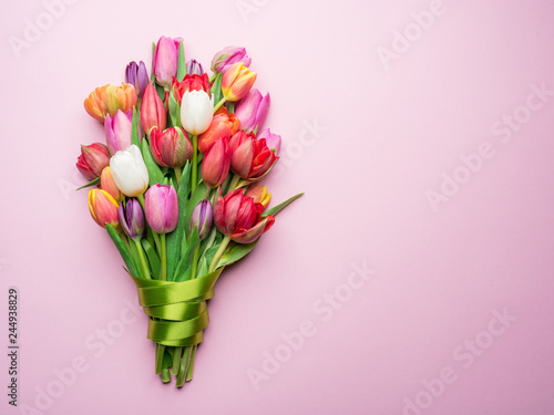 Slika na platnu Colorful bouquet of tulips on white background.