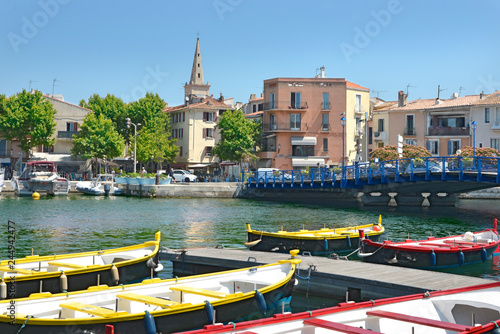 Foto op Plexiglas Poort Port and colored small boats at Martigues in France, a commune northwest of Marseille