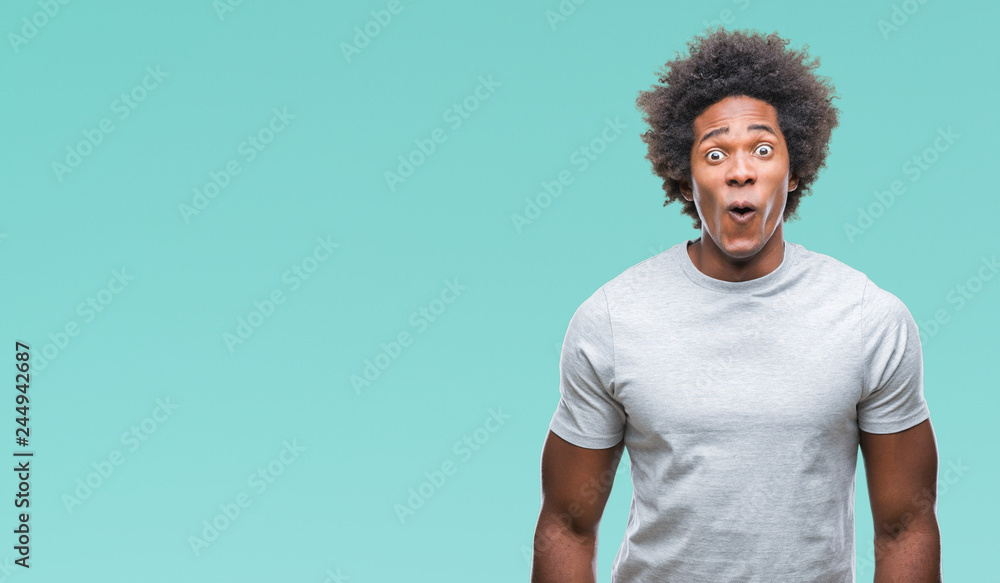 Fototapeta Afro american man over isolated background afraid and shocked with surprise expression, fear and excited face.