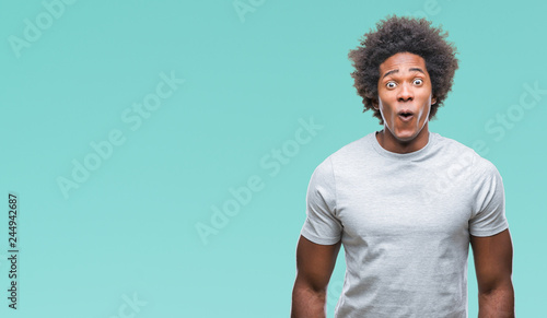 Tablou Canvas Afro american man over isolated background afraid and shocked with surprise expression, fear and excited face