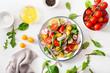 Leinwanddruck Bild - healthy colorful vegan tomato salad with cucumber, radish, onion