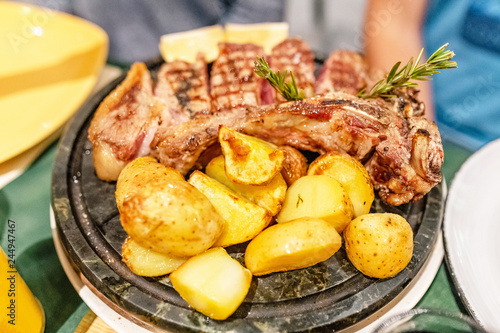 Tablou Canvas Traditional italian and tuscanian dish florentine steak in restaurant