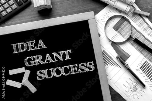 Cuadros en Lienzo Text Idea, Grant, Success on the blackboard on the desk with office business acc