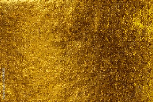 Valokuva  fond feuille d'or jaune briques de verre