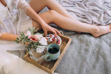 Obraz na płótnie Canvas breakfast in bed to the bride. soft focus