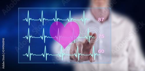 Man touching a heart beats graph concept Canvas Print