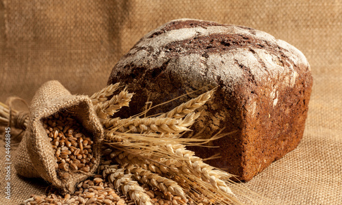 Canvas Prints Coffee beans Retro bread in rustic style background.Fresh traditional bread on wooden ground with flour in a sack.