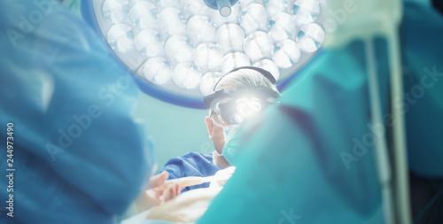 Obraz na płótnie surgeon with lights doing open heart cardiac surgery in hospital cardiovascular