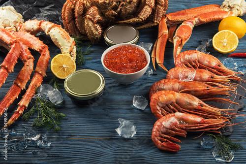 Pinturas sobre lienzo  Set of seafood: red and black caviar, limb of hairy crab, limb of snow crab, far