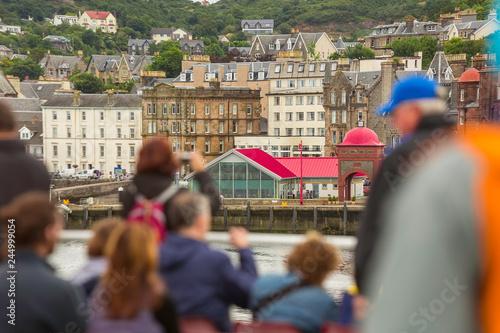 Obraz na płótnie Ferry Tourists on a Looking Towards Oban Scotland