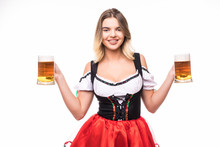 Young Sexy Woman Wearing A Dirndl With Two Beer Mugs Over White Background