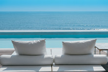 Luxury Swimming Pool On Sea View And Beach Chair In Hotel Resort