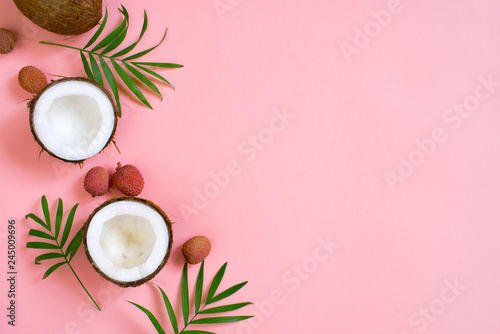 Foto auf Leinwand Palms Pink tropical background with coconut and palm leaves