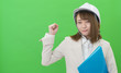 Leinwanddruck Bild - ヘルメットと作業服の女性 ガッツポーズ グリーンバック