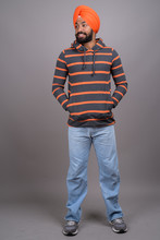 Full Length Shot Of Young Handsome Indian Sikh Man With Turban